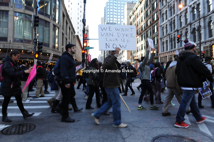 Protesters calling on Chicago Mayor Rahm Emanuel to resign on State Street in the Loop in Chicago, Illinois on December 9, 2015.  Emanuel offered a historic apology for the police killing of Laquan McDonald and police brutality and racial profiling generally -- without using those words -- in front of the City Council in the morning.