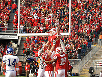 Wisconsin's Luke Swan celebrates a 35-3 victory over Buffalo with teammates Andy Crooks (#43) and Paul Hubbard (#19) on Saturday at Camp Randal Stadium in Madison