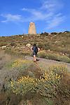Woman walking Torre Vigia de los Lobos Rodalquilar, Cabo de Gata natural park, Almeria, Spain