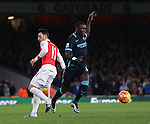 Arsenal's Mesut Ozil tussles with Manchester City's Bacary Sagna<br /> <br /> Barclays Premier League- Arsenal vs Manchester City - Emirates Stadium - England - 21st December 2015 - Picture David Klein/Sportimage