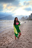 BRAZIL, Rio de Janiero, a young girl wraps herself in the Brazilian flag on Ipanema Beach