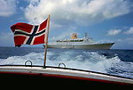 Norwegian flag on the end of a ships tender heading for shore. Caribbean 1976.
