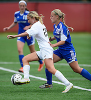 Oregon's Jen Brien gets past Green Bay Southwest's Emily Burg, as Gracie Corbett looks on. Oregon tops Green Bay Southwest 3-0 to win the WIAA Division 2 girls soccer state championship, on Saturday, June 20, 2015 at Uihlein Soccer Park in Milwaukee, Wisconsin