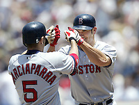 Johnny Damon of the Boston Red Sox is greeted by his teammate Nomar Garciaparra after scoring during a 2002 MLB season game against the Los Angeles Dodgers at Dodger Stadium, in Los Angeles, California. (Larry Goren/Four Seam Images)