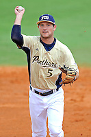 18 March 2012:  FIU infielder/outfielder Tyler James Shantz (5) throws to first after fielding a ground ball as the Florida Atlantic University Owls defeated the FIU Golden Panthers, 9-3, at University Park in Miami, Florida.