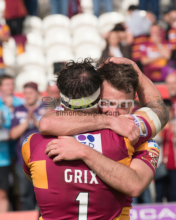 Picture by Allan McKenzie/SWpix.com - 24/09/2016 - Rugby League - First Utility Super League - The Qualifiers - Hull KR v Huddersfield Giants - KC Lightstream Stadium, Hull, England - Huddersfield's Scott Grix and Ryan Brierley embrace as their side defeat Hull KR to stay in Super League for 2017.