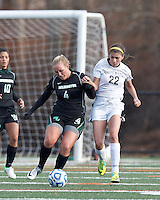Wilmington University forward Brittany Rhodes (4) attempts to control the ball as College of St Rose forward Gianna Smith (22) defends.. In 2012 NCAA Division II Women's Soccer Championship Tournament First Round, College of St Rose (white) defeated Wilmington University (black), 3-0, on Ronald J. Abdow Field at American International College on November 9, 2012.