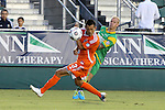 14 September 2013: Carolina's Kupono Low (3) ducks away from a cross by Tampa Bay's Luke Mulholland (ENG) (behind). The Carolina RailHawks played the Tampa Bay Rowdies at WakeMed Stadium in Cary, North Carolina in a North American Soccer League Fall 2013 Season regular season game. The game ended in a 2-2 tie.