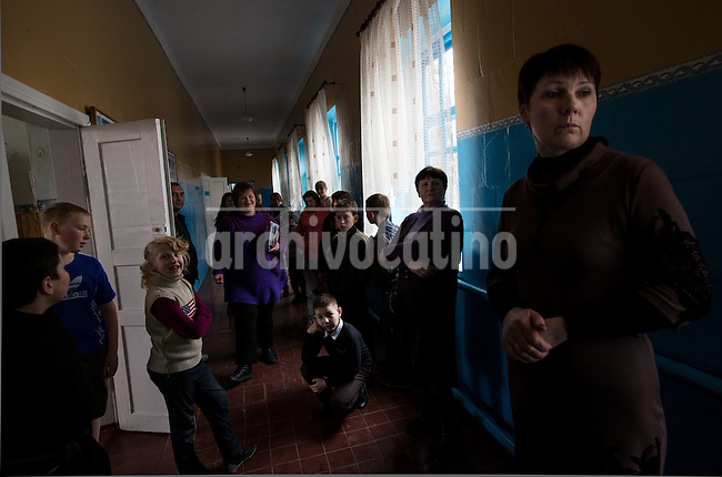 Pupils in a schoold in the town of  Veliki Solonzi, in Poltava region, eastern Ukraine. Most kids deserted the schoold and the region when pro  Russian groups tried to seize control of the place. The portrait in the wall shows writer  Taras Shevchenko, a symbol of free Ukraine