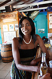EXUMA, Bahamas. A local woman at the Staniel Cay Yacht Club in Staniel Cay.