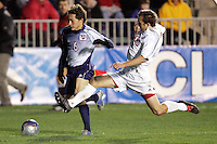 Maryland's David Glaudemans (right) stretches to prevent a cross from SMU's Duke Hashimoto. The University of Maryland defeated Southern Methodist University 4-1 in the NCAA Semifinal at SAS Stadium in Cary, North Carolina, Friday, December 9, 2005.