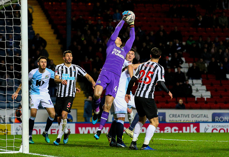 Newcastle United's Freddie Woodman wins a cross under pressure from Blackburn Rovers' Darragh Lenihan<br /> <br /> Photographer Alex Dodd/CameraSport<br /> <br /> Emirates FA Cup Third Round Replay - Blackburn Rovers v Newcastle United - Tuesday 15th January 2019 - Ewood Park - Blackburn<br />  <br /> World Copyright © 2019 CameraSport. All rights reserved. 43 Linden Ave. Countesthorpe. Leicester. England. LE8 5PG - Tel: +44 (0) 116 277 4147 - admin@camerasport.com - www.camerasport.com