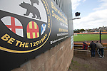 English, Scottish and Northumbrian flags on a sign inside Shielfield Park, before the Scottish League Two fixture between Berwick Rangers and East Stirlingshire. The home club occupied a unique position in Scottish football as they are based in Berwick-upon-Tweed, which lies a few miles inside England. Berwick won the match by 5-0, watched by a crowd of 509.