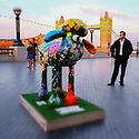 London, UK. 07.04.2015. Shaun the Sheep, charity sculpture, The Shard, London, UK. Petal, at More London. Photograph © Jane Hobson.