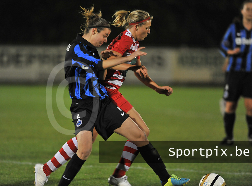 20131001 - VARSENARE , BELGIUM : Antwerp Sophie Mannaert (right) pictured in a duel with Brugge's Nicky Van Den Abbeele (left) during the female soccer match between Club Brugge Vrouwen and Royal Antwerp FC Ladies , of the fifth matchday in the BENELEAGUE competition. Tuesday 1 October 2013. PHOTO DAVID CATRY