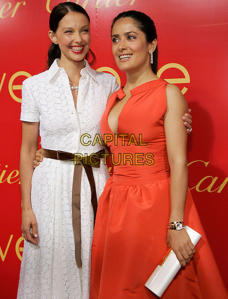ASHLEY JUDD & SALMA HAYEK.at the Cartier Charity Love Bracelet Party - Red Carpet Arrivals, New York City, NY, USA, 8 June 2006..half length orange dress diamond dangly earrings white broderie anglaise shirt dress brown sash belt.Ref: ADM/JL.www.capitalpictures.com.sales@capitalpictures.com.©Jackson Lee/AdMedia/Capital Pictures.