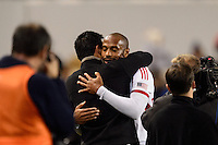Thierry Henry (14) of the New York Red Bulls hugs head coach Mike Petke after he was subbed out during the second half against the Chicago Fire. The New York Red Bulls defeated the Chicago Fire 5-2 during a Major League Soccer (MLS) match at Red Bull Arena in Harrison, NJ, on October 27, 2013.