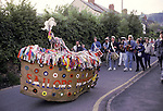 Minehead Hobby Horse Somerset. UK.  May Day at dawn walking to Whitecross where it bows three times to the sun before walking back to Minehead.