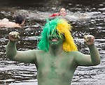 Walter McMorris, from Shelton, is all smiles as he raises his arms after leaping into the Burley Lagoon during the 25th annual Polar Bear jump in Olalla, Washington on January 1, 2009. Jim Bryant Photo. ©2010. ALL RIGHTS RESERVED.