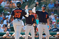 Detroit Tigers first baseman Niko Goodrum (28) is congratulated after hitting a home run in the top of the first inning during a Grapefruit League Spring Training game against the Baltimore Orioles on March 3, 2019 at Ed Smith Stadium in Sarasota, Florida.  Baltimore defeated Detroit 7-5.  (Mike Janes/Four Seam Images)