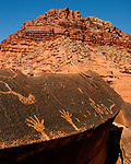 Petroglyphs chiseled on a boulder near Mexican Mountain on the San Rafael Swell in Utah.  These petroglyphs were carved into the rock between 800 and 1,500 years ago.