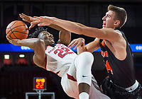 NWA Democrat-Gazette/BEN GOFF @NWABENGOFF <br /> Gabe Osabuohien (22) of Arkansas attempts a shot as Caleb Hodnett of Tusculum fouls him in the first half Friday, Oct. 26, 2018, during an exhibition game in Bud Walton Arena in Fayetteville.