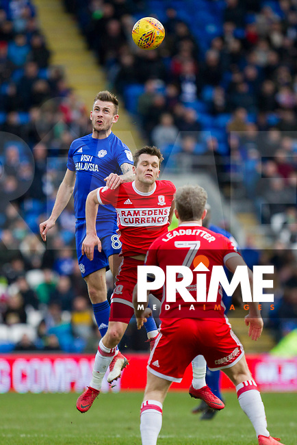 Joe Ralls of Cardiff City wins a header from Jonathan Howson of Middlesbrough during the Sky Bet Championship match between Cardiff City and Middlesbrough at the Cardiff City Stadium, Cardiff, Wales on 17 February 2018. Photo by Mark Hawkins / PRiME Media Images.