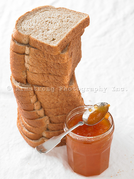 Sliced Whole Wheat Bread with jar of orange marmalade jam