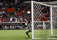 WASHINGTON, DC - July 28, 2012:  Dwayne DeRosario (7) of DC United beats  Nicolas Douchez (1) of PSG (Paris Saint-Germain) to score from a penalty kick in an international friendly match at RFK Stadium in Washington DC on July 28. The game ended in a 1-1 tie.