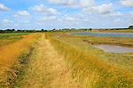 Butley Creek river landscape, Boyton, Suffolk, England, UK footpath on flood defence bank wall