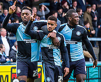 Paris Cowan-Hall (centre) of Wycombe Wanderers Gozie Ugwu (left) of Wycombe Wanderers  & Aaron Pierre of Wycombe Wanderers celebrate before realising the goal is disallowed  during the Sky Bet League 2 match between Wycombe Wanderers and Luton Town at Adams Park, High Wycombe, England on 6 February 2016. Photo by Massimo Martino.
