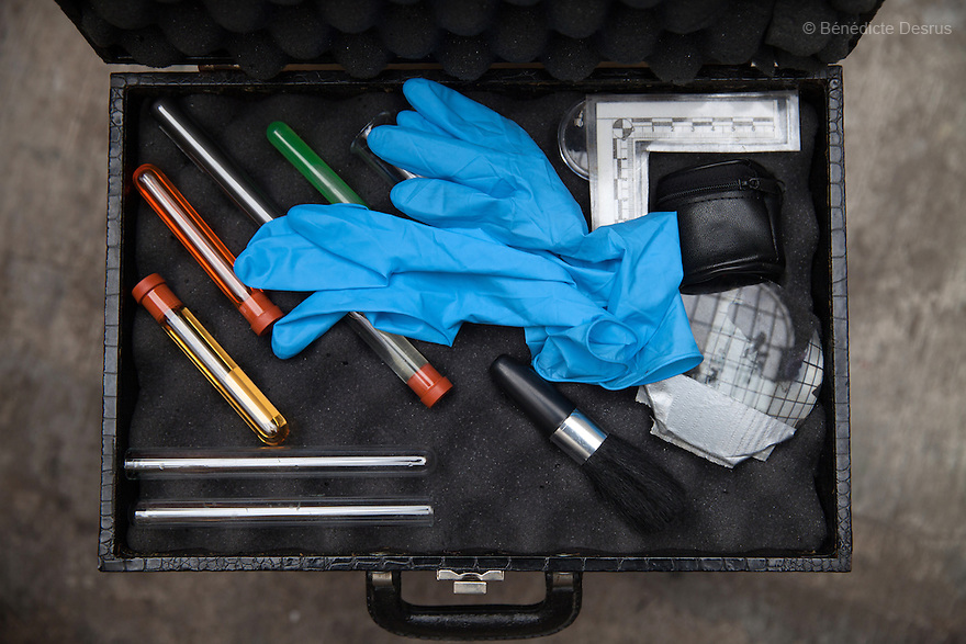 """Close-up of Donovan's forensic cleaning kit at his home in Texcoo, Mexico on September 21, 2015. The kit includes gloves and some of the 370 formulas he has devised –and memorized– in order to carry out his forensic cleaning. The chemical base for some of his formulas, he says, can cost up to $6,000. Donovan Tavera, 43, is the director of """"Limpieza Forense México"""", the country's first and so far the only government-accredited forensic cleaning company. Since 2000, Tavera, a self-taught forensic technician, and his family have offered services to clean up homicides, unattended death, suicides, the homes of compulsive hoarders and houses destroyed by fire or flooding. Despite rising violence that has left 70,000 people dead and 23,000 disappeared since 2006, Mexico has only one certified forensic cleaner. As a consequence, the biological hazards associated with crime scenes are going unchecked all around the country. Photo by Bénédicte Desrus"""