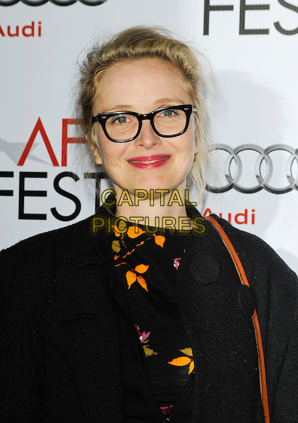 "JULIE DELPY.arriving at AFI Fest's Gala Screening of ""The Road"" at Grauman's Chinese Theatre in Hollywood, California.  November 4th 2009..portrait headshot geek glasses black frames yellow print .CAP/ROT.©Lee Roth/Capital Pictures"