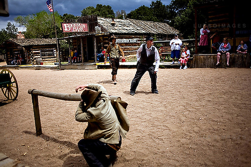 Actors Josh Berkowitz, Dan Ford, Nicholas Hyatt, and Josh Bales perform seven daily gunfights --culminating in a hanging towards the end of the day --at Buckskin Joe's recreation of a western town of the same name.  The town is comprised of buildings transferred one piece at a time from several defunct frontier towns and has been the set for several western movies graced by stars such as John Wayne and Goldie Hawn.