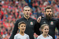 Gareth Bale and Joe Ledley of Wales sing the national anthem ahead of during the FIFA World Cup Qualifier match between Wales and Georgia at the Cardiff City Stadium, Cardiff, Wales on 9 October 2016. Photo by Mark  Hawkins / PRiME Media Images.