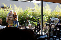 Los Angeles, California, November 14, 2009 - Portrait of Ernie and Diane Wolfe in the garden outside of their home, based on a Quonset hut. The Wolfe's own the Ernie Wolfe Gallery and are the most reknowned African at dealers in the country. ..CREDIT: Daryl Peveto/LUCEO for The Wall Street Journal.Homefront - Ernie Wolfe #1348.