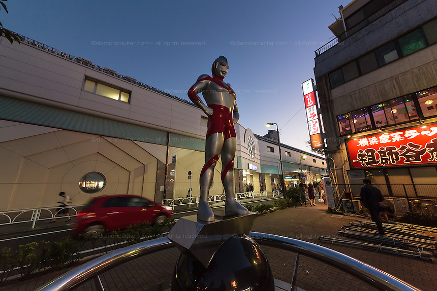 A statue of Ultraman stands guard near the train station in Soshigaya-Okura (Ultraman Town), Tokyo, Japan. Sunday October 25th 2015