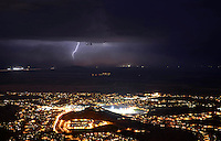 Aug. 21, 2012; Phoenix, AZ, USA: lightning bolt storm monsoon night thunderstorm Ahwatukee foothills city lights dust storm rain  South Mountain Mandatory Credit: Mark J. Rebilas