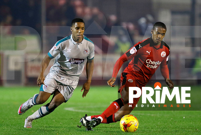 Crawley's Lewis Young is closed down by Grimsby's Rhys Browne during the Sky Bet League 2 match between Crawley Town and Grimsby Town at Broadfield Stadium, Crawley, England on 26 November 2016. Photo by Carlton Myrie PRiME Media Images.