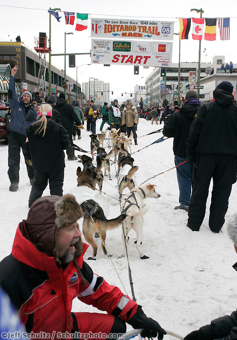 "Matt Hayashida's team waits ""on deck"" near the start line in Anchorage on Saturday March 1st during the ceremonial start day of the 2008 Iidtarod Sled Dog Race."