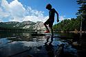 Barrage de l'Ospedale, Corsica, France: 01/08/2018: A young boy plays in the Barrage de l'Ospedale high in the Corscian Mountains near Porto Vecchio, Corscia as a tempatures reached well into the high 30's on the Mediterranean island. Photo/Paul McErlane