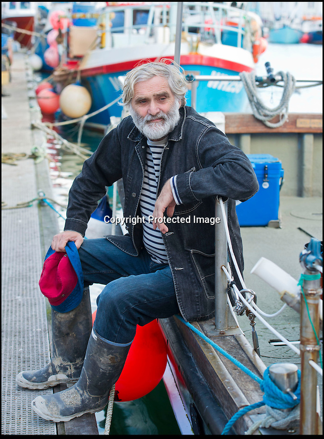 BNPS.co.uk (01202 558833)<br /> Pic: RachelAdams/BNPS<br /> <br /> Kevin Nurrish takes a break from fishing in Weymouth Quay<br /> <br /> Lights, camera, plankton!<br /> <br /> A crew of fishermen are enjoying unlikely sideline careers as actors in blockbuster films - thanks to their salty sea dog looks.<br /> <br /> The gang's craggy features, big beards and wild hair have helped them bag roles alongside Hollywood A-listers such as Johnny Depp and Charlize Theron.<br /> <br /> As many as 12 weather-beaten fishermen from Weymouth, Dorset, have found success on the big screen since signing up with a casting agency.<br /> <br /> And thanks to their authentic appearances they are regularly snapped by film producers wanting to make nautical scenes more realistic.