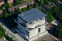 GERMANY Hamburg, IBA international architecture exhibition, an old anti-aircraft war bunker is changed into an 25.500 MW renewable energy project, with biomass, biogas, solar panels and solar thermal vacuum pipes / DEUTSCHLAND  Hamburg, Energiebunker Wilhelmsburg , IBA Projekt, Energieerzeugung aus Solarenergie, Biogas, Holzhackschnitzeln und Abwaerme aus einem benachbarten Industriebetrieb, der Energiebunker soll einen Teil des Reiherstiegviertels mit Waerme versorgen und gleichzeitig erneuerbaren Strom in das Stromnetz einspeisen. Der Energiebunker soll circa 22.500 MWh Waerme und fast 3.000 MWh Strom erzeugen. Das entspricht dem Waermebedarf von circa 3.000 Haushalten und dem Strombedarf von etwa 1.000 Haushalten, Solon PV Module an der Suedseite des ehemaligen Flakbunkers, auf dem Dach wurde von Ritter XL Solar Deutschlands groesste Vakuumroehrenkollektoren Anlage zur Warmwassererzeugung installiert