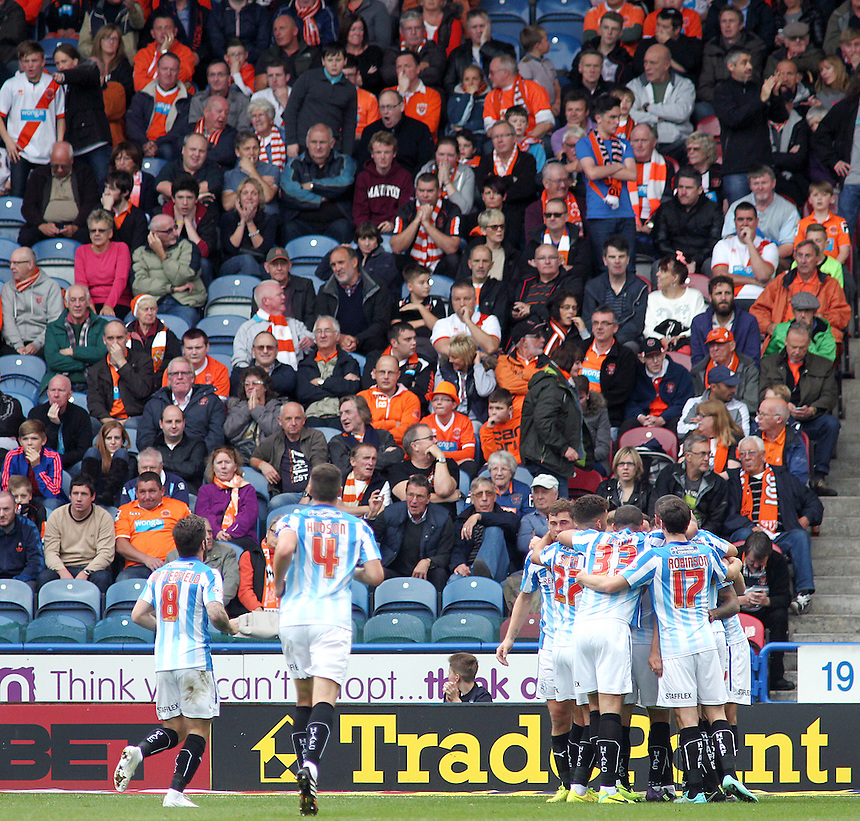 Blackpool fans watch in dismay as Huddersfield Town players celebrate scoring their third goal during the opening half<br /> <br /> Photographer Rich Linley/CameraSport<br /> <br /> Football - The Football League Sky Bet Championship - Huddersfield Town v Blackpool  - Saturday 18th October 2014 - The John Smith's Stadium - Huddersfield<br /> <br /> &copy; CameraSport - 43 Linden Ave. Countesthorpe. Leicester. England. LE8 5PG - Tel: +44 (0) 116 277 4147 - admin@camerasport.com - www.camerasport.com