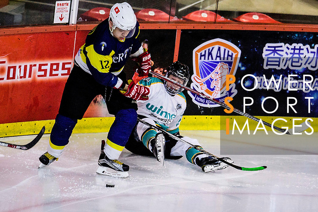 Medical Kings Skater #27 Dennis Yee (r) is put into the boards by Verity Skater #12 Leo Kan (l) during the Principal Standard League match between Medical Winner Kings vs Verity at the Mega Ice on 17 January 2017 in Hong Kong, China. Photo by Marcio Rodrigo Machado / Power Sport Images