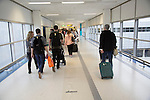 Passengers walking with luggage along corridor in Gatwick airport north terminal, London, England, UK
