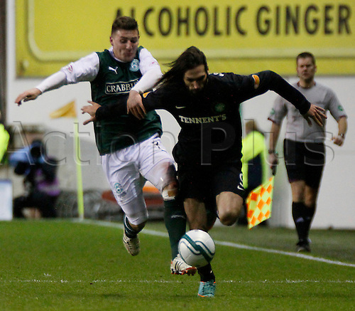 29.12.2012 Edinburgh, Scotland. Georgios Samaras tries to hold off Gary Deegan during the Scottish Premier League game between Hibernian and Celtic from Easter Road.