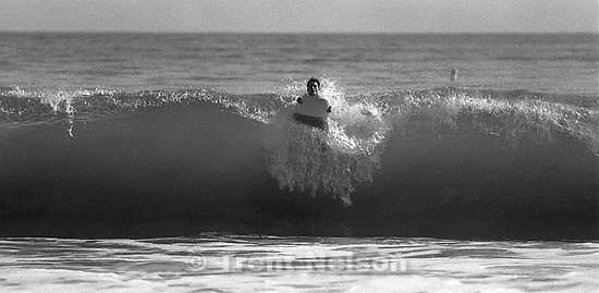 Trent Nelson boogie-boarding. photo by Paul Doerr<br />