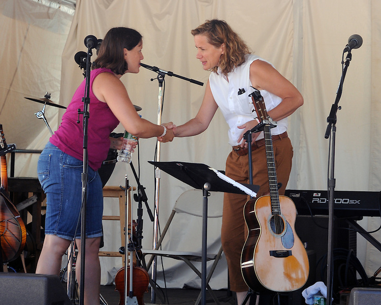 "Kara Kulpa, of Pesky J Nixon, greets Susan Werner, before the start of the 'Gospel Wake Up Call"" Show at the  Main Stage of the Falcon Ridge Folk Festival, held on Dodd's Farm in Hillsdale, NY on Sunday, August 2, 2015. Photo by Jim Peppler. Copyright Jim Peppler 2015."