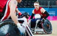 18 APR 2012 - LONDON, GBR - Great Britain's Aaron Phipps (GBR) (Class 3.5) (right) looks for a way through the Canadian defence during their London International Invitational Wheelchair Rugby Tournament match at the Olympic Park Basketball Arena in Stratford, London, Great Britain (PHOTO (C) 2012 NIGEL FARROW)